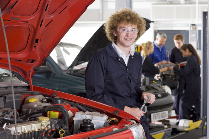 Male Student in Auto Repair Class